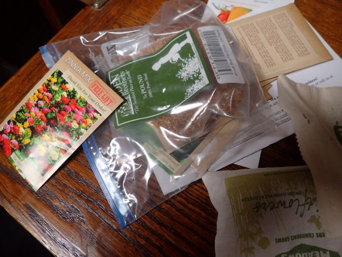 flower seed packets scattered on a desk